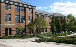 Picture of the side of Deschutes Hall, facing the entrance, taken next to the sundial